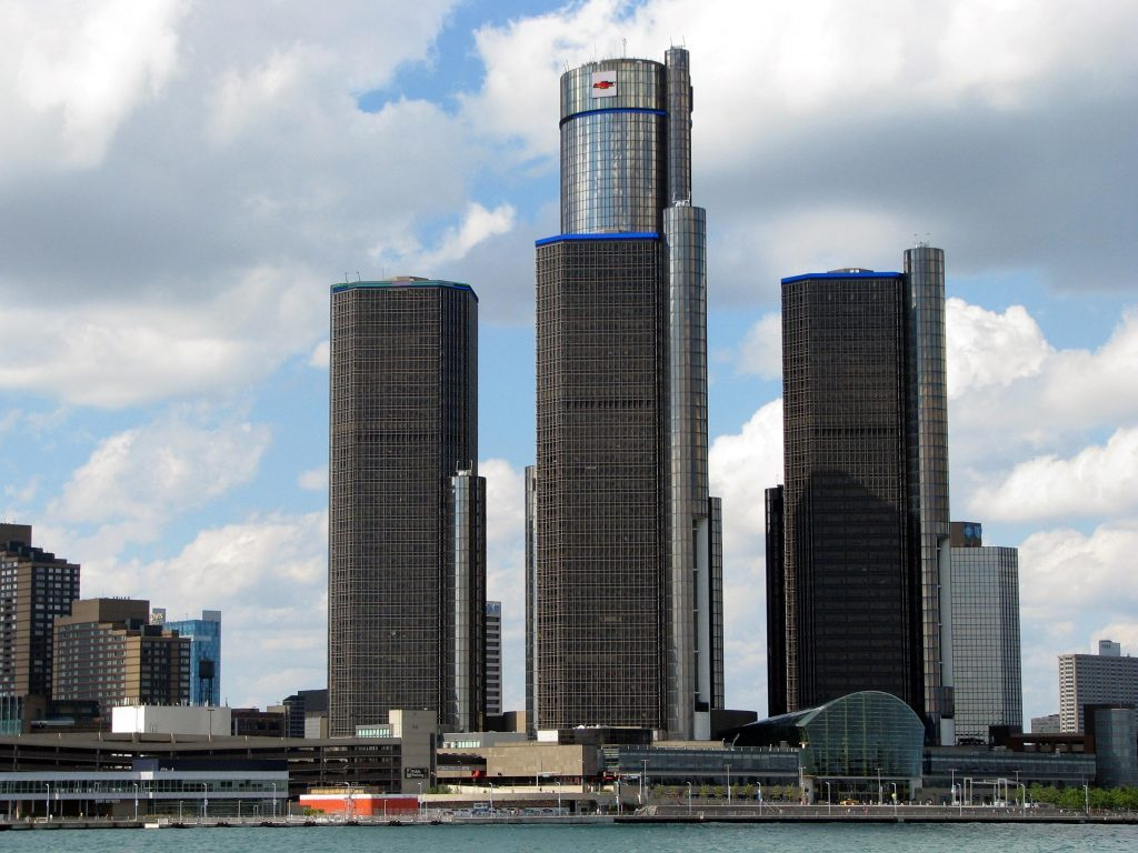 Windsor, Ont./Canada-July 13, 2014: From across the Detroit River, the towers of the Renaissance Center complex stand out in stark relief against blue sky and light clouds over Detroit.