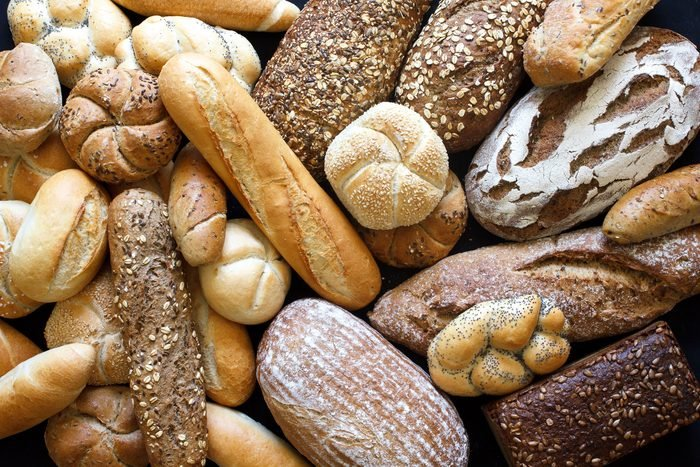 Many mixed breads and rolls shot from above