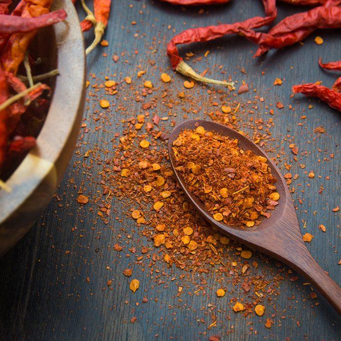 Cayenne pepper on the wooden floor; Shutterstock ID 418894738