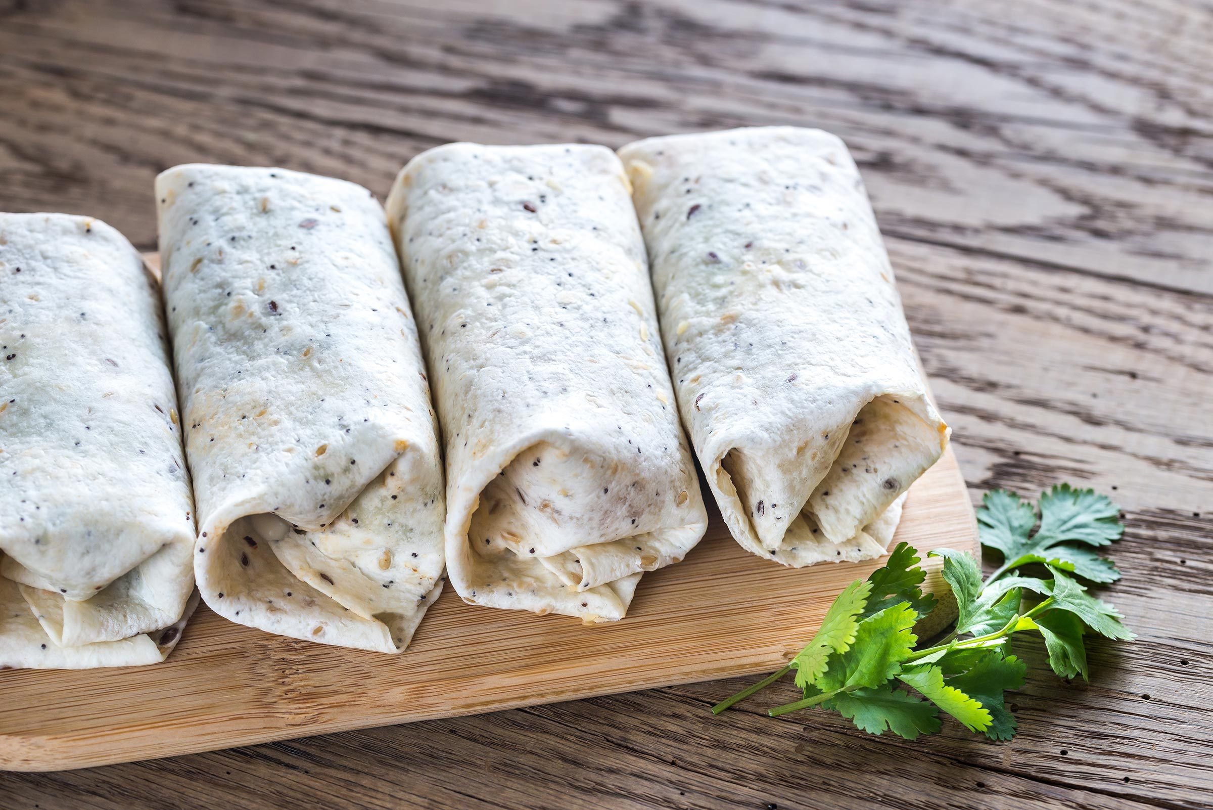 Chicken burritos on the wooden background