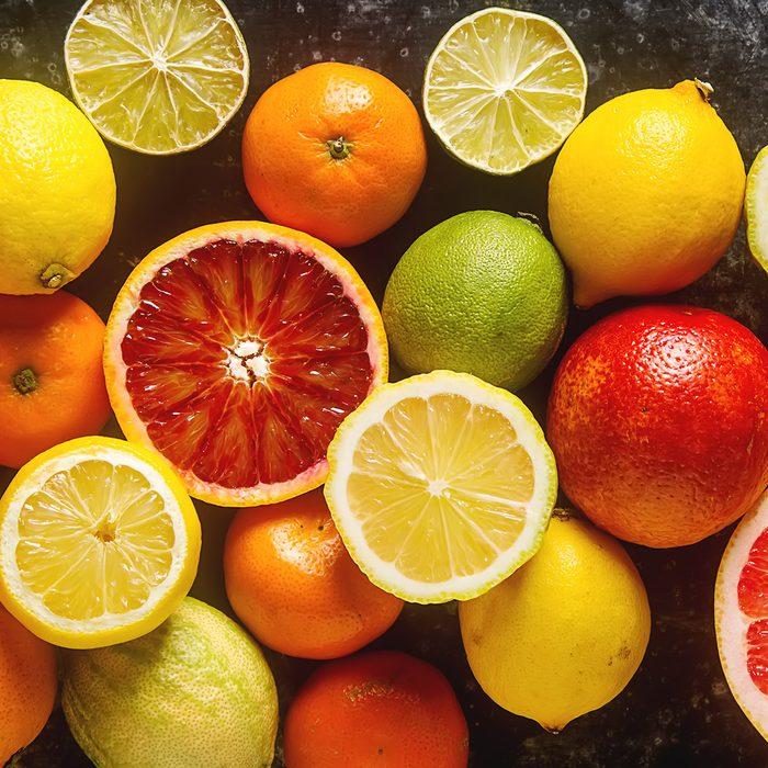 Citrus juice fruit and slices of orange, grapefruit, lemon, lime. Vitamin C. Black background. ; Shutterstock ID 588497897