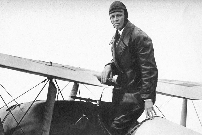 Charles Lindbergh (1902 - 1974) in his flying kit standing in 'Spirit of St Louis', the plane in which he made the first non - stop Atlantic air crossing: 20 - 21 May 1927. Landed at Le Bourget Airdrome, Paris, after a flight of 33.5 hours