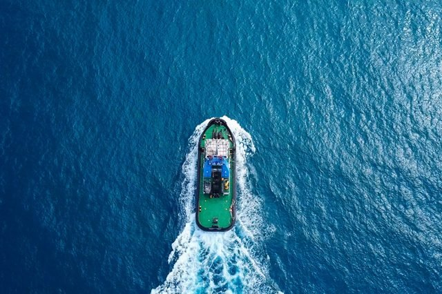 Tugboat at sea - Aerial image