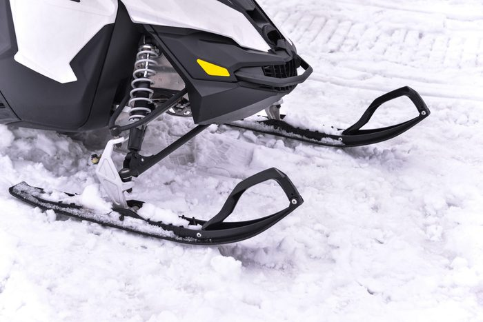 Snowmobile skiing on snow close up