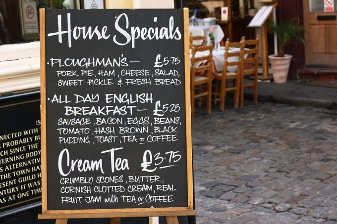 House Special menu board with a street cafe or restaurant in the background
