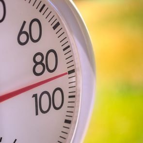 Outside Thermometer showing ninety degree hot summerday
