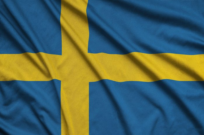 Sweden flag is depicted on a sports cloth fabric with many folds. Sport team banner