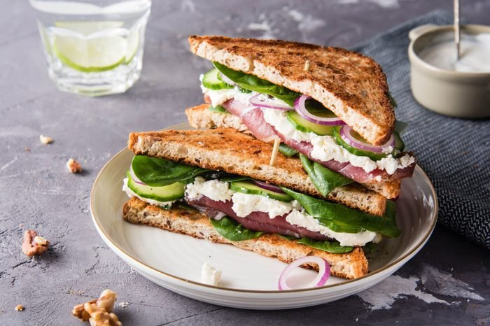 Sandwiches with cream cheese, ham and spinach.