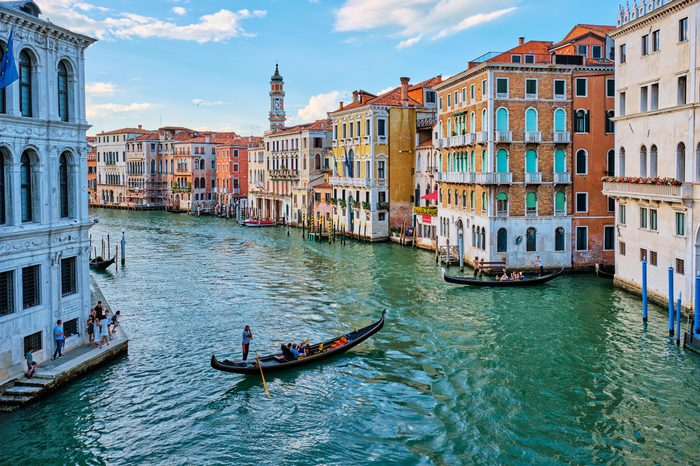 VENICE, ITALY - JUNE 27, 2018: Grand Canal with boats and gondolas on sunset, Venice, Italy