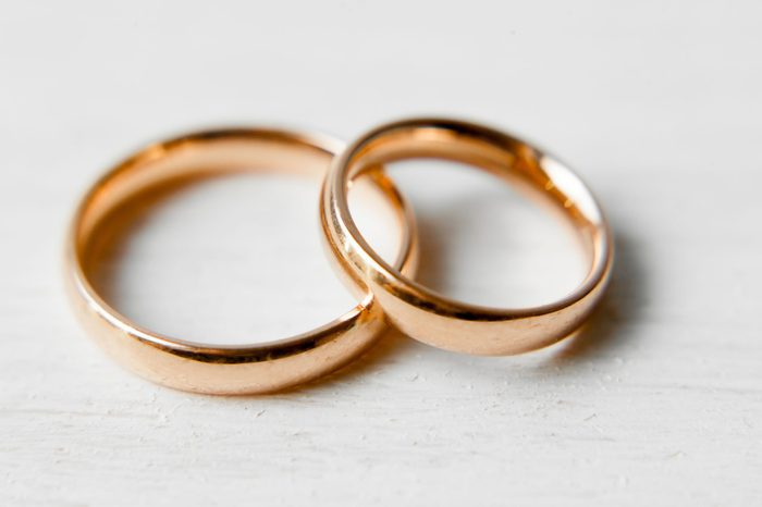 gold engagement rings on white background