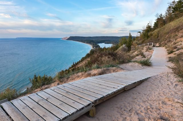 A weathered wooden walkway on the Empire Bluffs Trail is the perfect overlook to see Lake Michigan, the Sleeping Bear Dunes, and the Manitou island