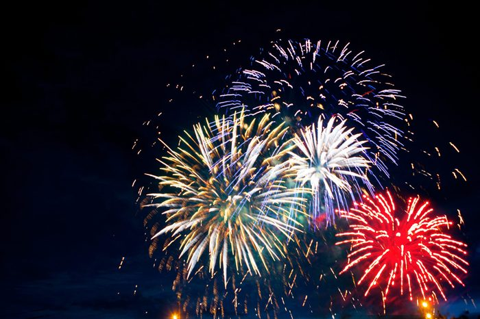 Gorgeous multi-colored fireworks display on dark background, with copyspace
