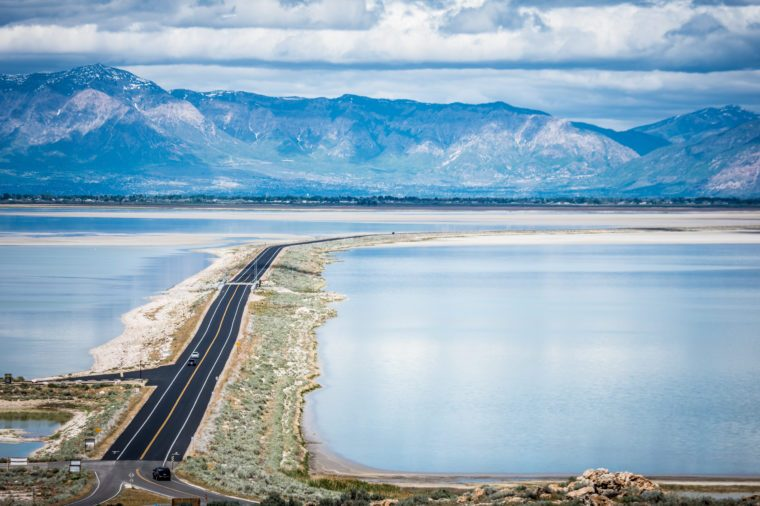 Road leading into Antelope Island State Park in Utah is on a barrier island causeway, crossing the Bridger Bay in Great Salt Lake