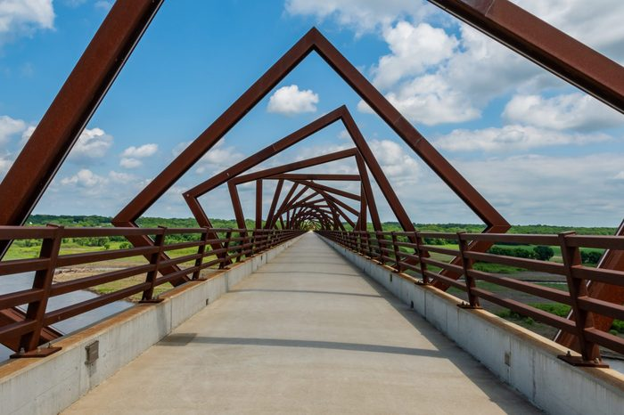 Twisting Bridge Over Rails to Trail on Sunny Day