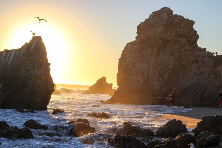 The sun sets at El Matador Beach in Malibu, California.