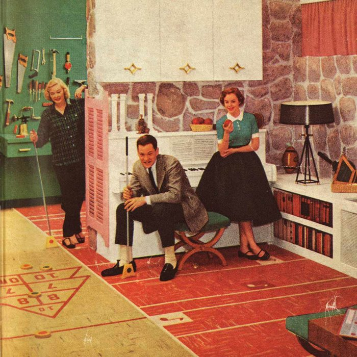 Group gathers in the basement to play shuffleboard in 1950s