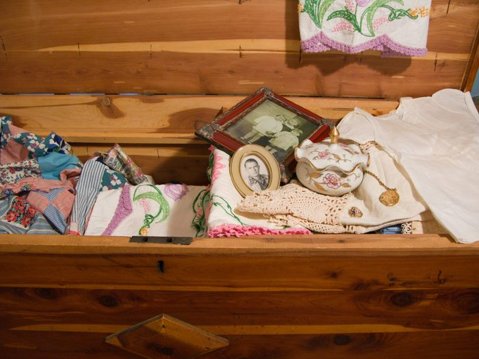 antique cedar chest with vintage linens, photographs and knicknacks