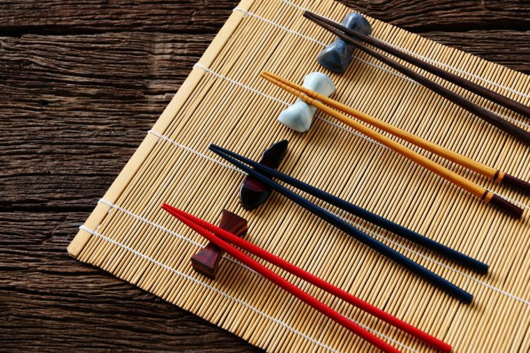 chopsticks on bamboo mat background.Flat lay,Copy space