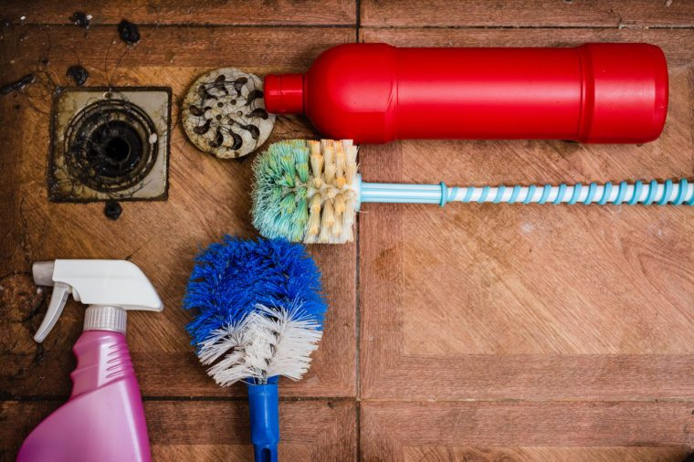 cleaning tool on dirty floor in bathroom