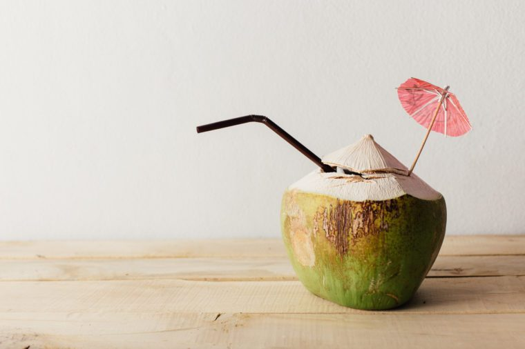 coconut on wooden floor with white background