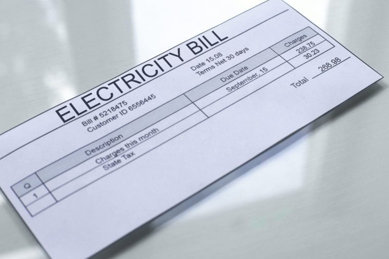 Electricity bill lying on table, payment for services, month expenses, tariff