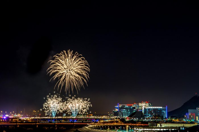 Tempe Lake Fireworks - fireworks bursts over the Tempe Lake, Arizona skyline on the fourth of July, 2016. A six second exposure renders beautiful fireworks patterns.