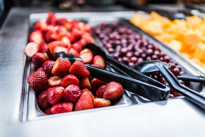 Fruit salad bar with whole strawberries and grapes