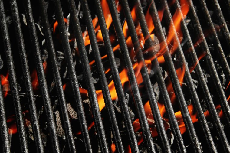 Stock image of charcoal fire grill, close up with live flames