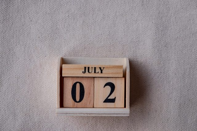 July 2nd. Image of July 2 wooden color calendar on white canvas background. empty space for text
