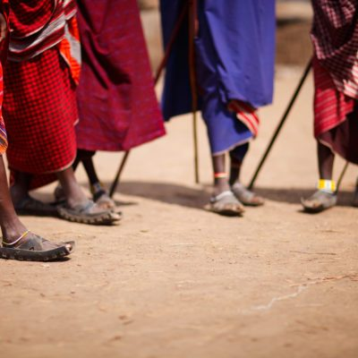 Group of masai people participating in traditional dance with high jumps