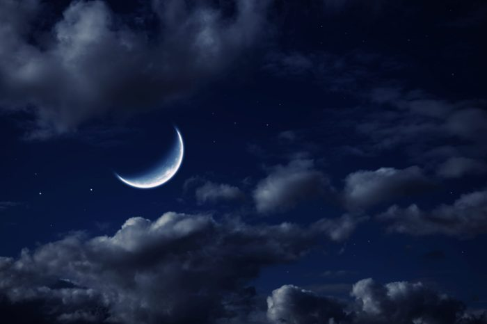 The moon in the night cloudy sky with stars