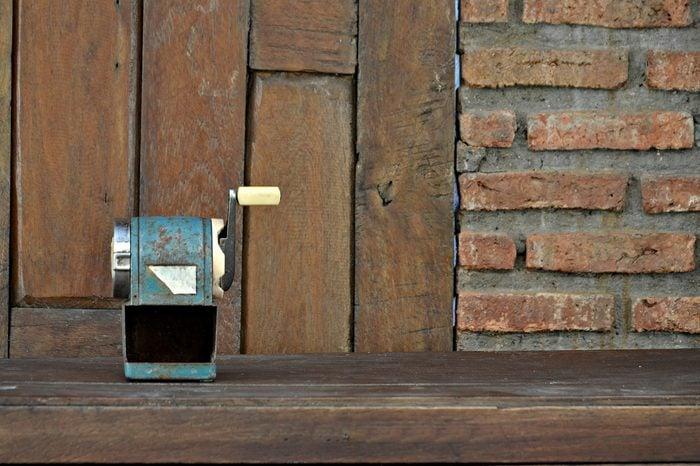 old pencil sharpener out of order,vintage wall