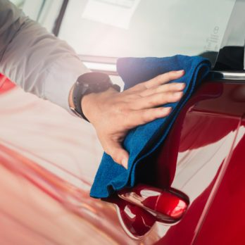 Man asian inspection and cleaning Equipment car wash With red car For cleaning to quality to customer on car showroom of service transport automobile transportation automotive image.