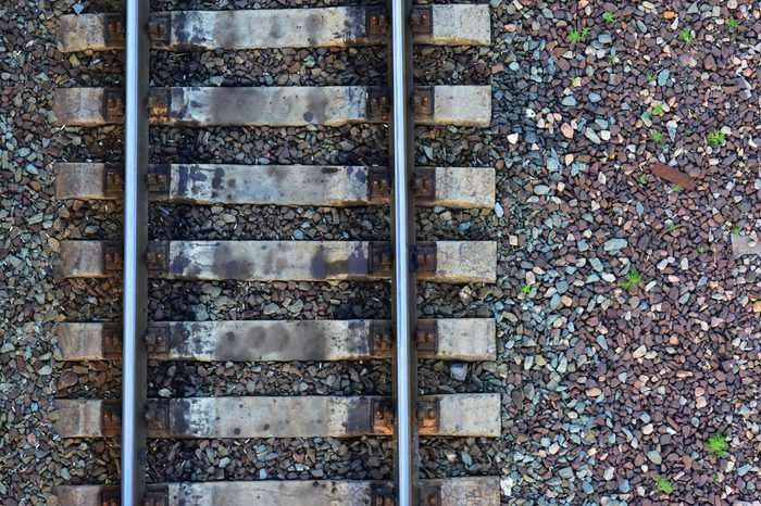 Fragment of the old railway close-up. View from above. Background freight transport