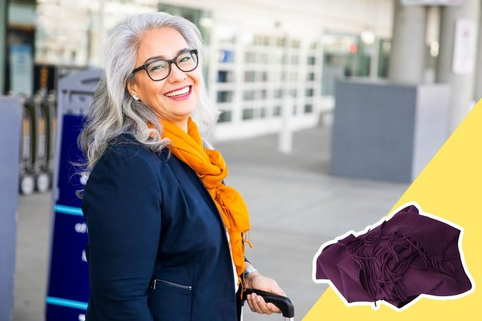 woman wearing scarf at airport with inset of scarf to buy