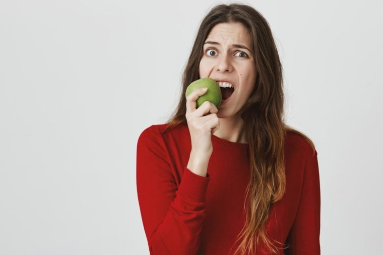 girl apple awkward