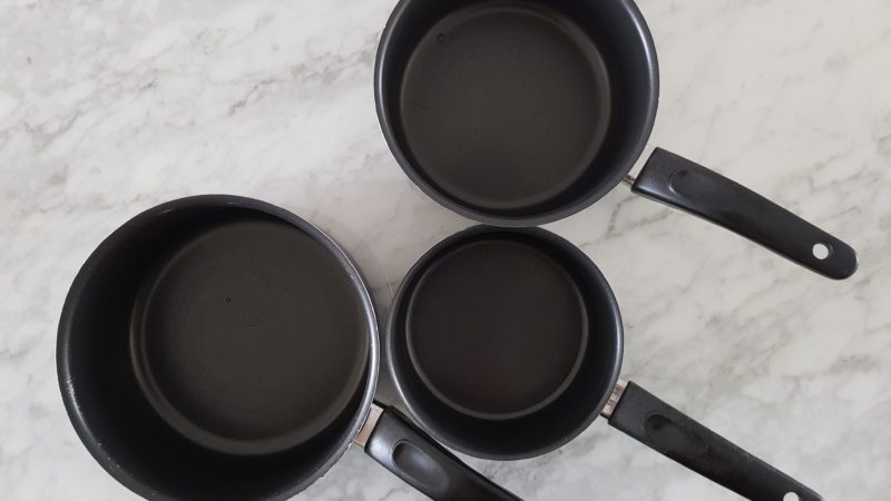 Three saucepans with handles