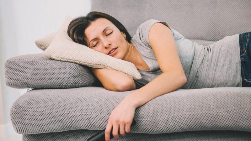 woman sleeping remote tv