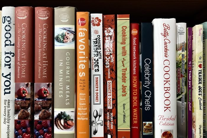 """Minneapolis, MN/USA. January 5th, 2019. Cookbooks on display on a shelf in Minneapolis including """"Cooking at Trader Joe's"""" and """" Gourmet Meals in Minutes."""""""