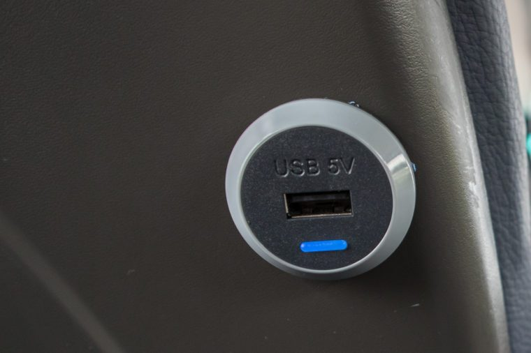 USB charging port on back of seat.