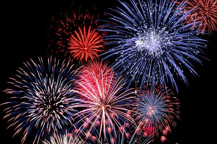 Colourful blue, red and pink fireworks display for celebrations