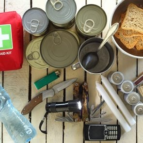Items for emergency on wooden table; Shutterstock ID 518832568