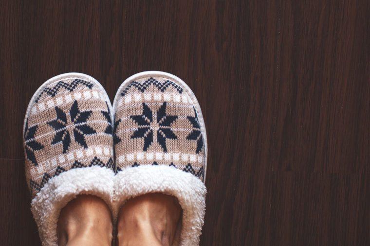 Slippers on floor at bedroom. Soft comfortable home slipper