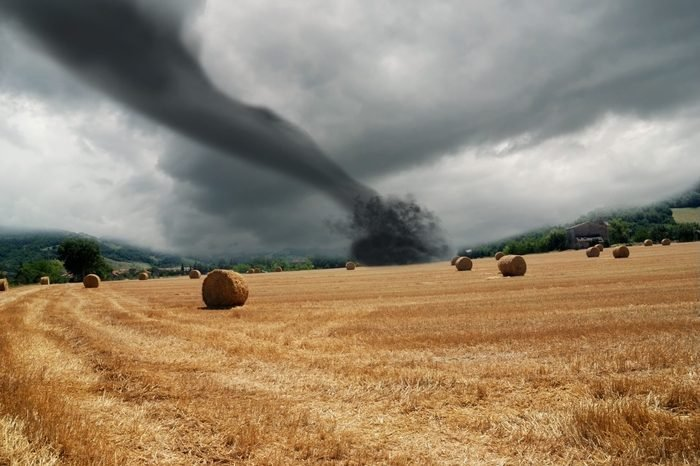 twister on countryside with dark sky