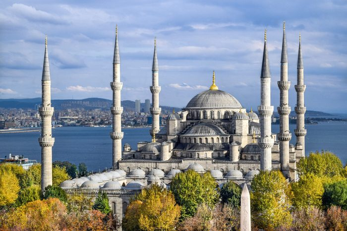 Aerial shot of Blue Mosque (Sultan Ahmed Mosque) surrounded by trees in Istanbul's Old City - Sultanahmet, Istanbul, Turkey [Autumn/ Fall Colors]