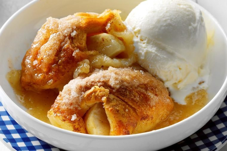 A bowl of Apple Dumpling Bake with melting vanilla ice cream
