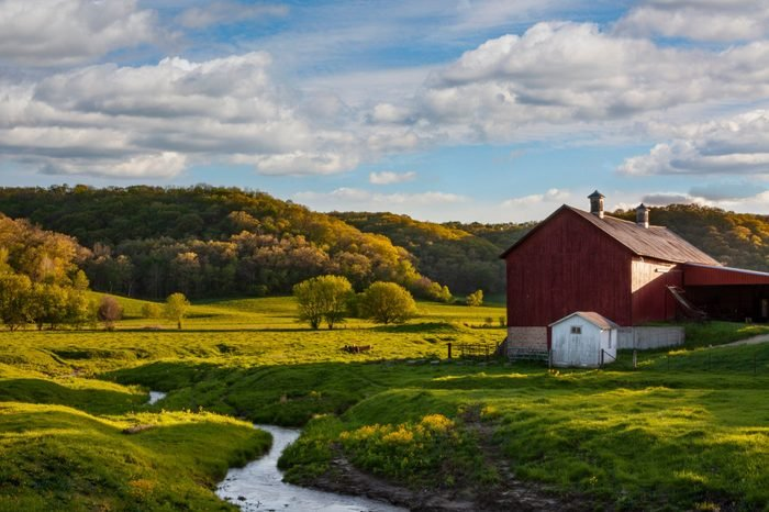 Beautiful old red barn in spring