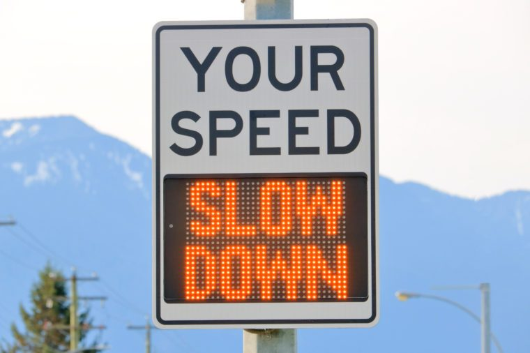 Close on an electronic sign that displays a message to slow down when the motorist or driver is traveling an unlawful speed.