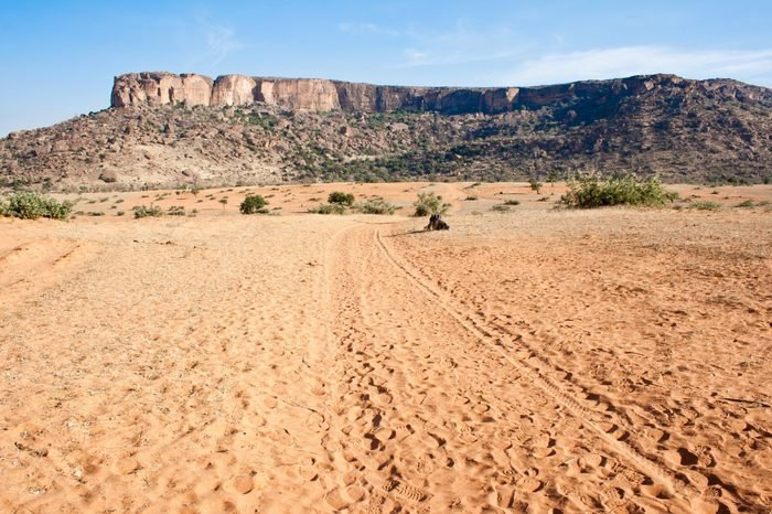 Desert at the base of the cliff, Mali, Africa.