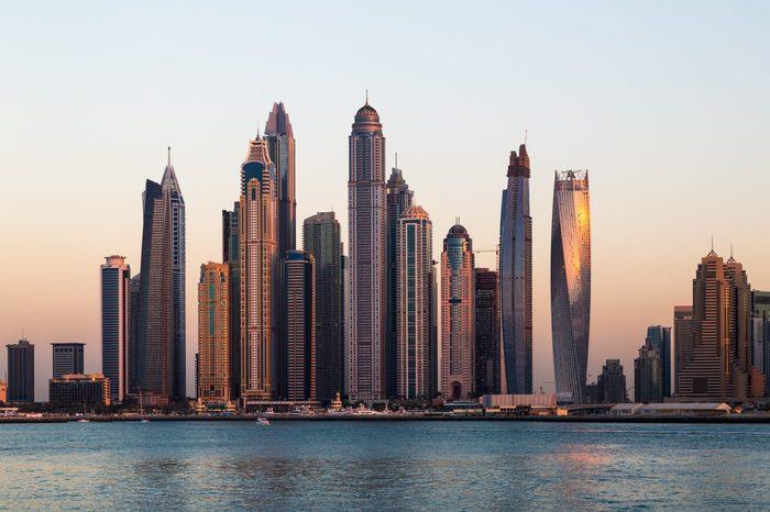 Dubai skyscrapers. Dubai Marina panoramic view, skyline, cityscape. Evening skyline. Dubai sunset. Dubai futuristic skyline. Skyscrapers Princess Tower, Cayan tower, Marina 101.